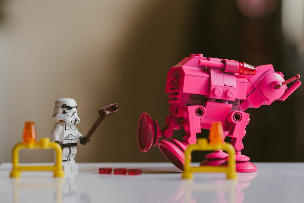 pink and yellow lego toy