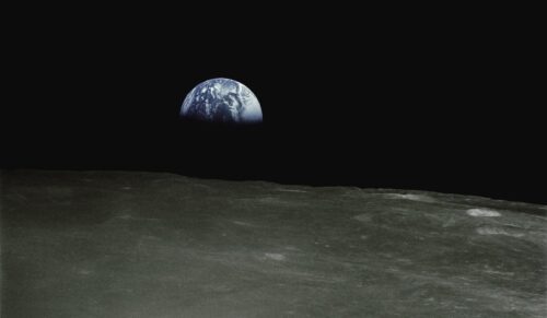 Earth rises above lunar surface