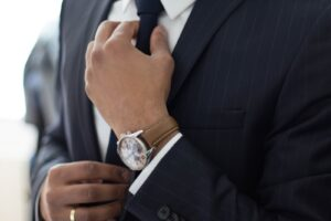 man wearing watch with black suit