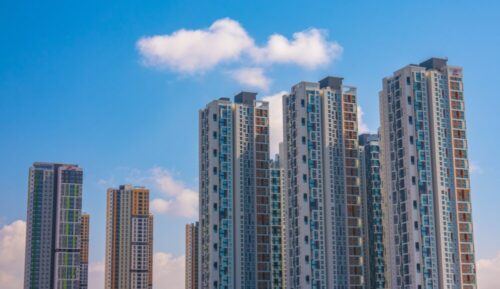 brown and gray high rise buildings under blue sky during daytime