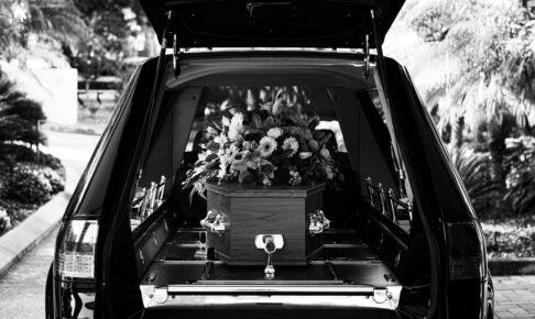 grayscale photo of car with flowers