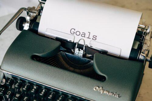black and white typewriter on green textile