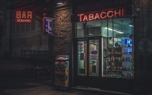 brown and black store front during night time