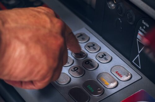 person holding gray and black control panel