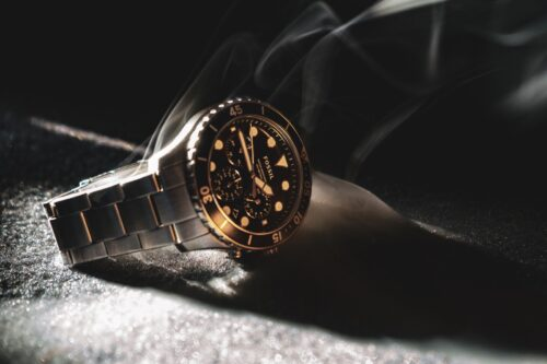 black and gold analog watch